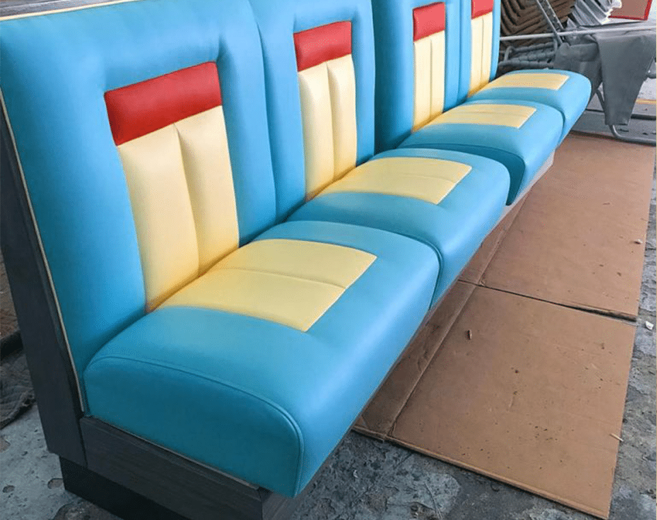 Custom Single Booths in Blue by Mega Seating and Design.
